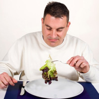 man eating lettuce